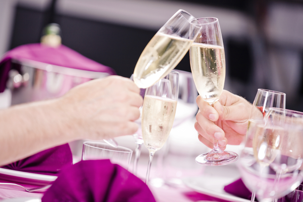 Champagne Glasses Clink - iStock_000020486635_Medium