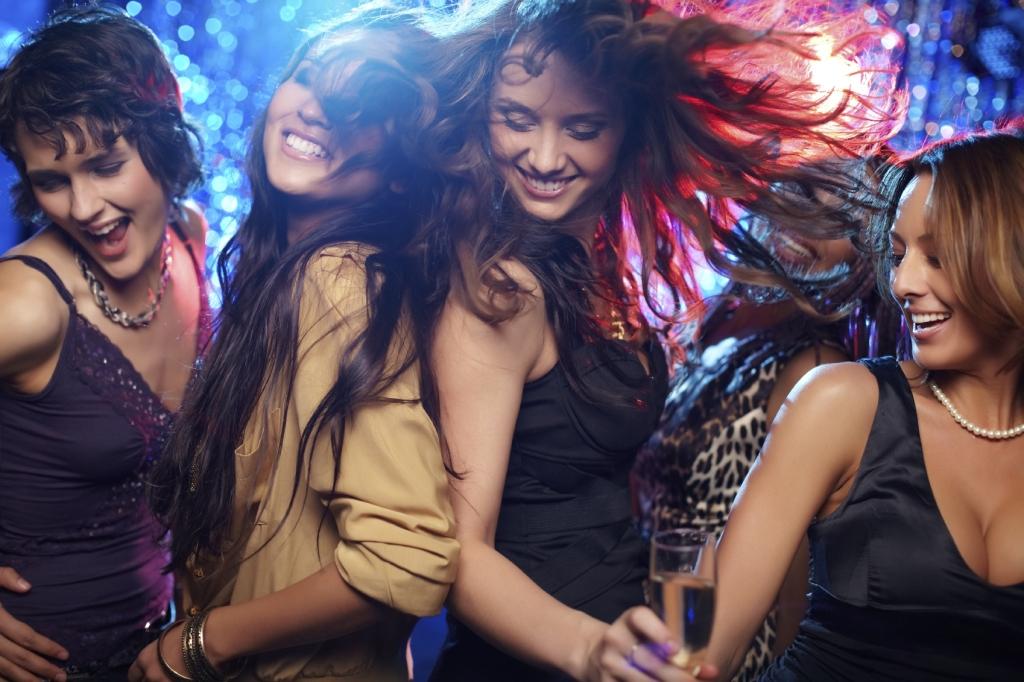 Young women having fun dancing at nightclub