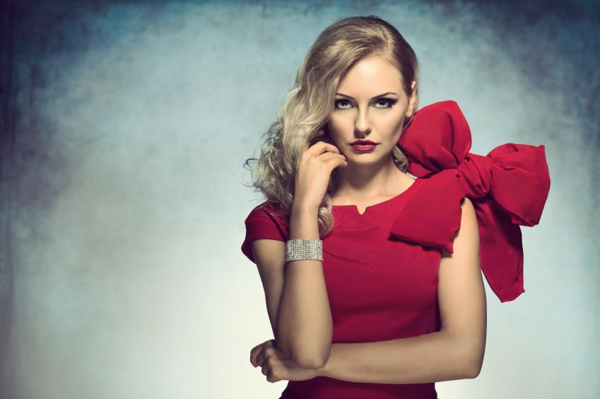 elegant girl looking in camera in red