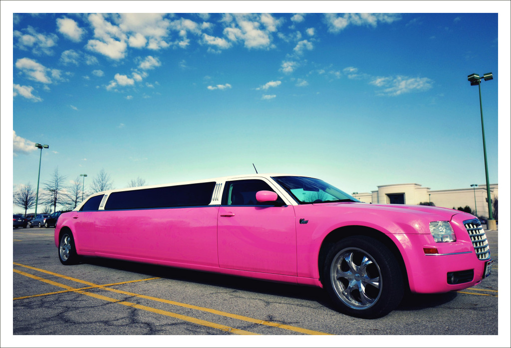 Bright  pink limousine from Swift Travel Limousines